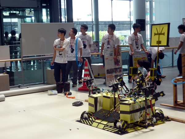 Showing off a robot made by students from Ichinoseki College of the National Institute of Technology