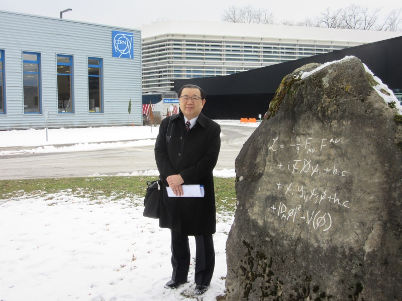 Vice-governor Chiba by the Standard Model Stone outside the CERN Control Centre