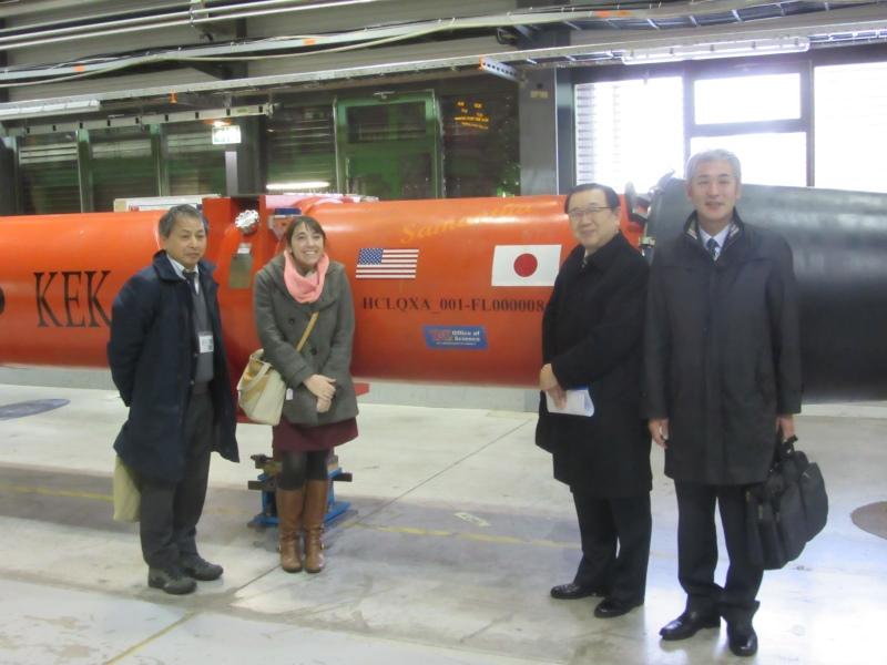 A cryomodule made through a partnership of the USA and Japan. From left to right: Prof. Akira Yamamoto (KEK), Amanda Wayama, Vice-governor Shigeki Chiba, Director Jun Sasaki of Iwate's ILC Promotion Office